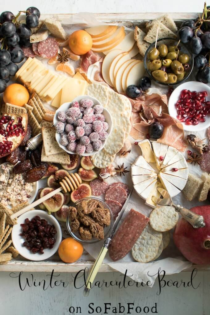 Learn how to make an Epic Charcuterie Board for impressive yet easy entertaining. This Winter Charcuterie Board is filled with meats, cheeses, veggies, nuts, olives, dried fruits, crackers, and more. An easy appetizer perfect for happy hour entertaining. #charcuterie #board #appetizers #newyears #cheese #olives #ad #sofabfood @sofabfood