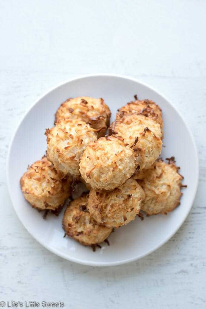 This is classic Coconut Macaroons cookie recipe has the option to be dipped in dark chocolate and sprinkled with sea salt crystals.  #coconutmacaroons #coconut #darkchocolate #cookies #seasalt #sweetenedcondensedmilk #sweetenedcoconutflakes