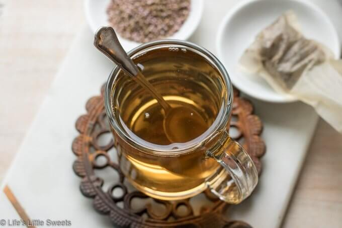 This Heather Flower Tea is a hot, strong herbal drink that helps sooth a cough, cold, congestion. Here is a tutorial on How to make Heather Tea to help get you through Wintertime or any time you are in need of restoration. #heatherflowers #heather #tea #remedy #tutorial #flowertea #coldremedy #glutenfree #hotdrink #drink #vegan #vegetarian
