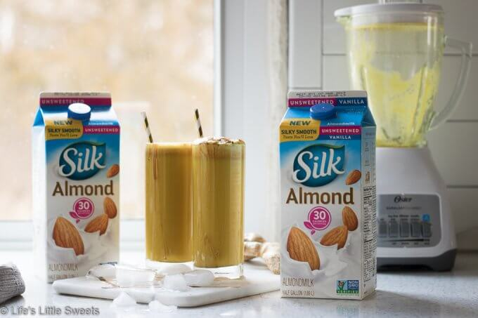 This Vegan Golden Milk Smoothie recipe is a spiced, non-dairy treat with turmeric, fresh ground black pepper, ground cinnamon and Silk Unsweetened Almondmilk! Naturally sweetened with maple syrup and optional dates. #ad #justaddsilk #CollectiveBias #vegan #goldenmilk #smoothie #Osterblender