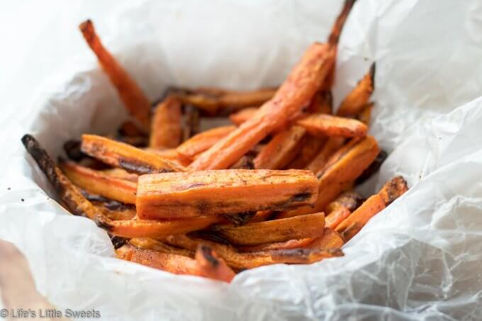Air Fryer Carrot Fries have ground cumin, smoked paprika, kosher salt and fresh ground pepper with a small amount of Canola oil. This is a more healthy version of carrot fries with less oil using an Air Fryer. This easy recipe only requires 7 ingredients and 15 minutes! (gluten free, vegan) #ad #carrots #carrot #fries #airfried #airfryer #easy #airfryercarrotfries #savory #recipe #cumin #paprika #salt #pepper