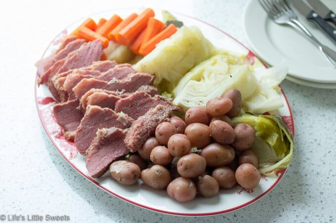 Corned Beef and Cabbage is a classic Irish-American family dinner popular to serve on St. Patrick's Day. This savory, delicious and complete meal is cooked in a Dutch Oven on the stove top with corned beef brisket, baby red potatoes, green cabbage wedges and carrots. #cornedbeefandcabbage #stpatricksday #carrots #redpotatoes #recipe #greencabbage #cabbage #Dutchoven #brisket
