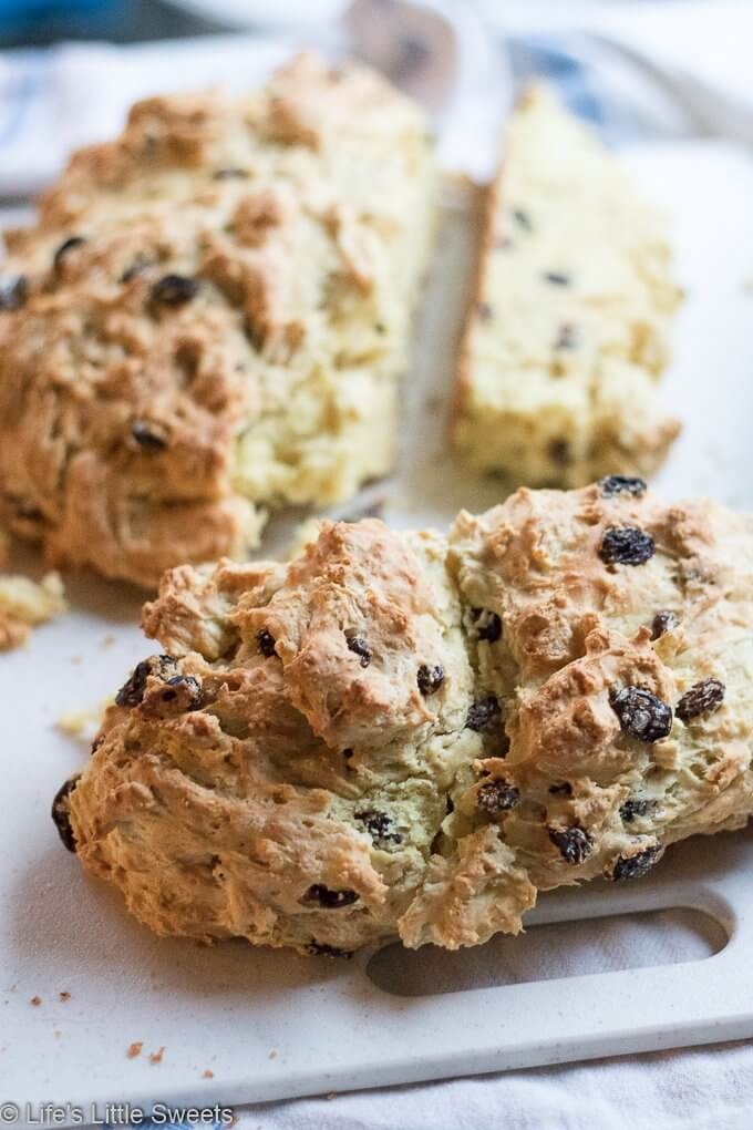 This Irish Soda Bread recipe has raisins (or currants) and optional caraway seeds; this round quick bread easy to make in your cast iron skillet, baked in the oven. Enjoy it for St. Patrick's Day or any time of the year. #sodabread #Irishsodabread #raisins #American #recipe #bread #quickbread #carawayseeds #StPatricksDay