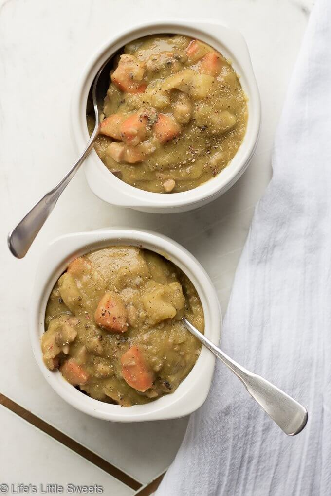 Split Pea Soup is hearty soup filled with protein, veggies and carbs, perfect for sustaining you during cold weather. Enjoy this classic, family soup recipe which is a meal in an of itself! #splitpeasoup #recipe #carrots #peas #potatoes #ham #savory #bayleaves #marjoram #celery