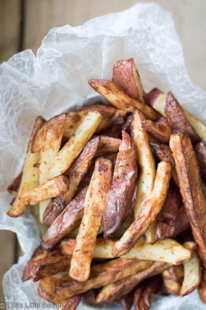 Air Fryer French Fries are savory cut potatoes seasoned with Kosher salt, cumin, smoked paprika, fresh ground black pepper, onion powder and a little bit of Canola oil. Try these easy to make, healthier than traditionally fried french fries using an Air Fryer. #Frenchfries #potatoes #airfryer #airfried #savory #appetizer #cumin #smokedpaprika