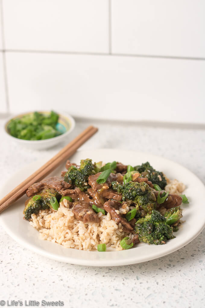 Homemade Beef and Broccoli over Brown Rice is a savory, stir-fry dish that has thin-cut strips of lean, flank steak, crisp, bite-size, broccoli florets, a savory, garlic-infused brown sauce over steaming hot, brown rice. Make this popular Chinese-American cuisine take-out dish at home! #beef #broccoli #brownrice #dinner #ChineseAmerican #takeout #homemade #recipe