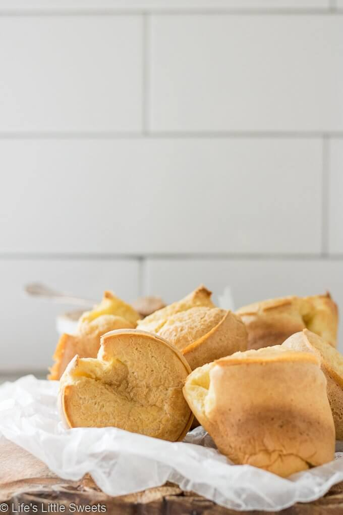 "Popovers are an American bread recipe made of an egg and flour-based batter baked in individual molds. Also, known as the ""American Yorkshire Pudding,"" this recipe dates back to 1850. They can be served any time of the day and are delicious when eaten fresh and topped with Maple Cinnamon Butter. Popovers recipe! #popovers #recipe #homemade #appetizer #bread #eggs"