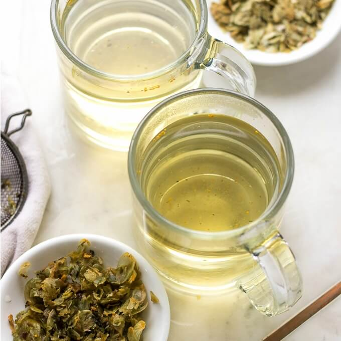 Hops Flower Tea is floral, slightly bitter tea with relaxing effects. You can enjoy it hot or cold with ice. #hops #hopsflowers #tea #hottea #drinks #recipe #herbaltea #hopsflowertea