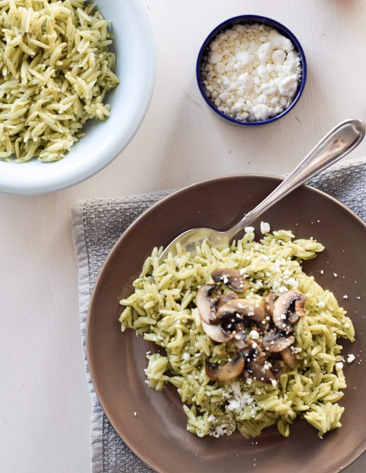 If you are are looking for something easy and impressive, look no further! Easy Mushroom Orzo with Basil Pesto is a quick pasta recipe that never fails to impress. I like to top it with crumbled goat cheese or ricotta with black pepper. I love the pesto because it is made with walnuts. Traditionally, pesto is made with pine nuts, but this can be expensive. By subbing walnuts you get the health benefits of them, and also a fun nutty flavor.