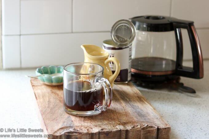 black coffee halfway filled in a clear mug