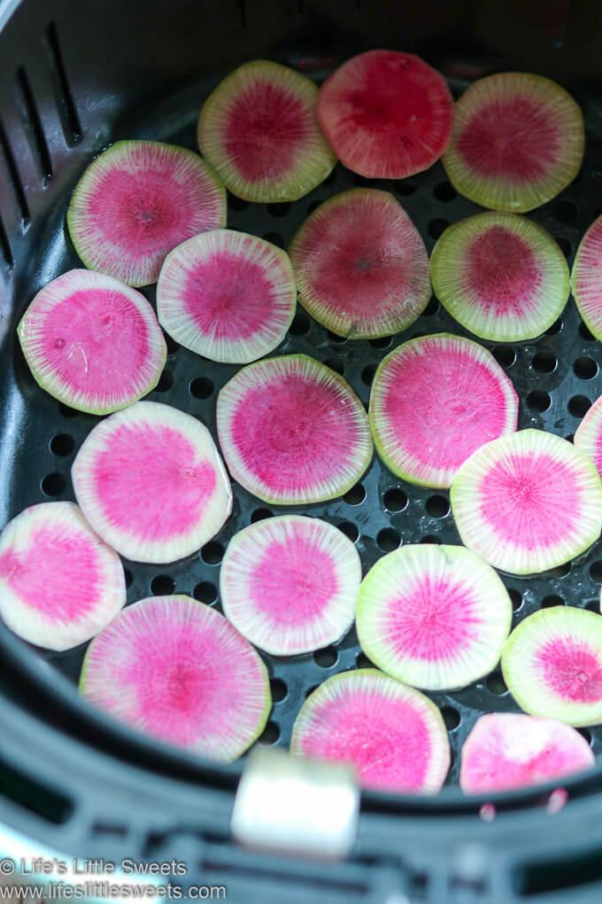 Watermelon Radish slices in an air fryer basket