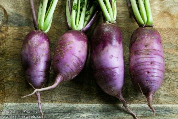 a row of 4 purple Radishes