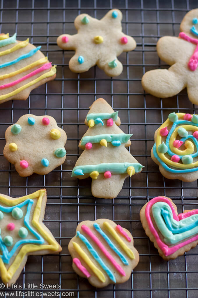 festive colorful Cutout Sugar Cookies on a cooling rack