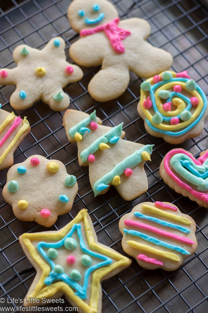Cutout Sugar Cookies on a cooling rack with colorful Royal Icing