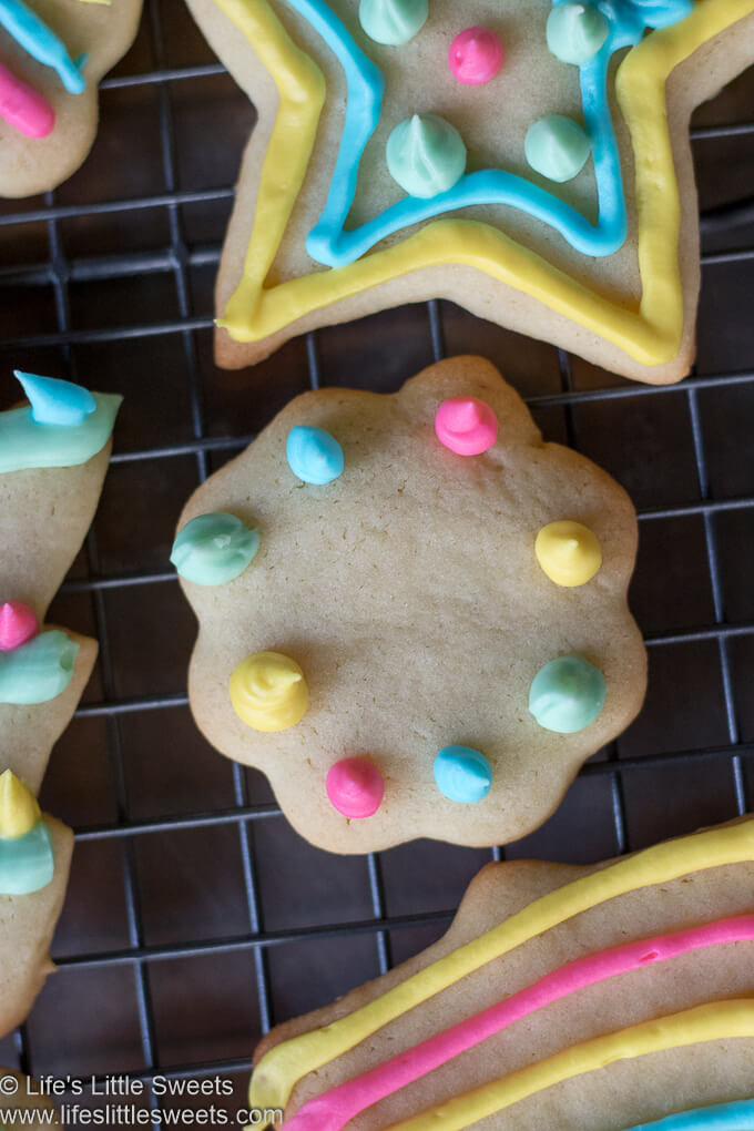 colorful decorated Cutout Sugar Cookies on a cooling rack