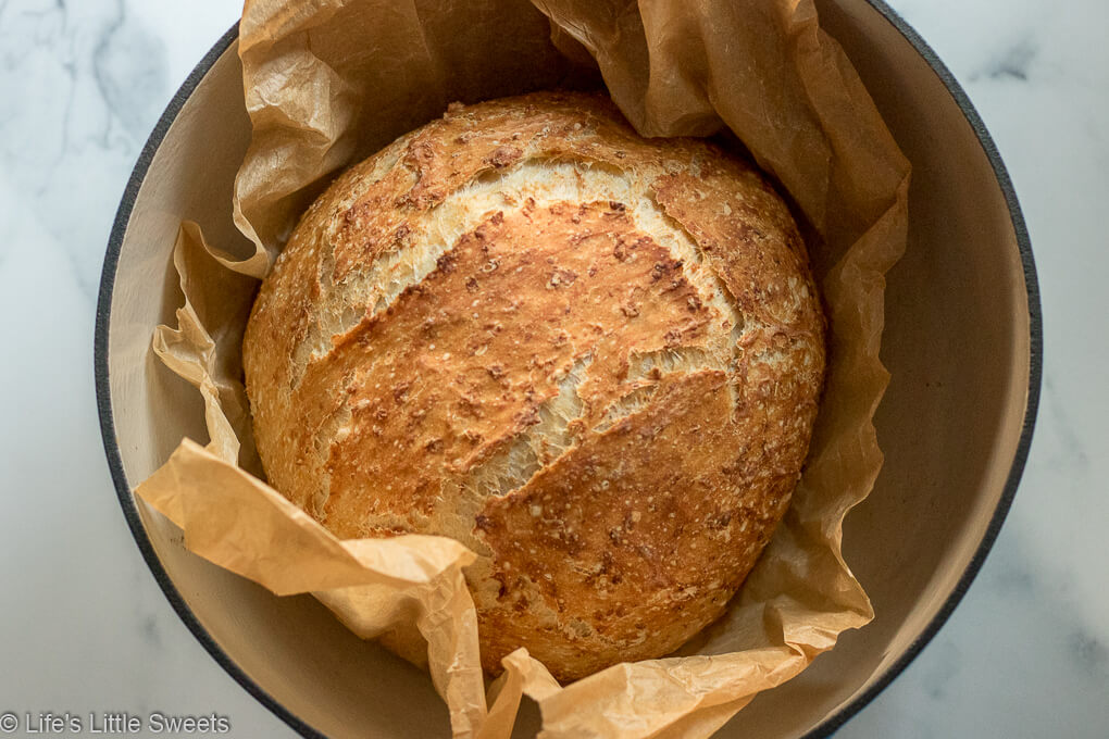 No-Knead Oatmeal Bread in a Dutch oven with parchment paper