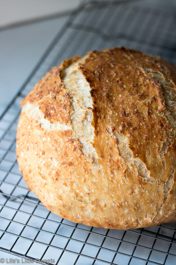 No-Knead Oatmeal Bread loaf cooling on a wire cooling rack