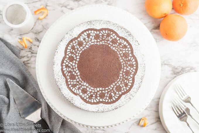 Chocolate Orange Almond Cake on a cake stand