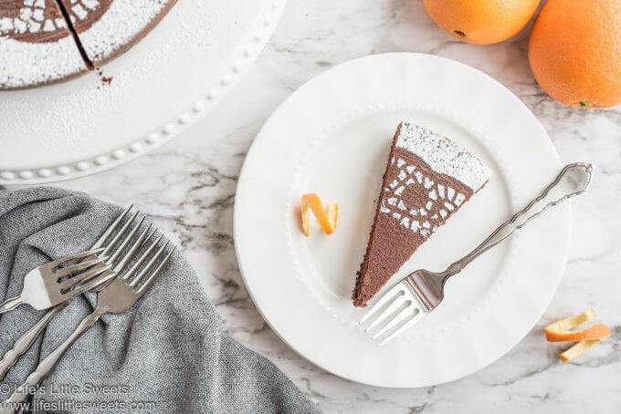 Chocolate Orange Almond Cake slice on a white plate
