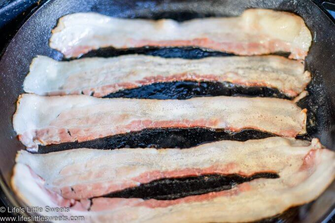 Bacon strips cooking in a pan