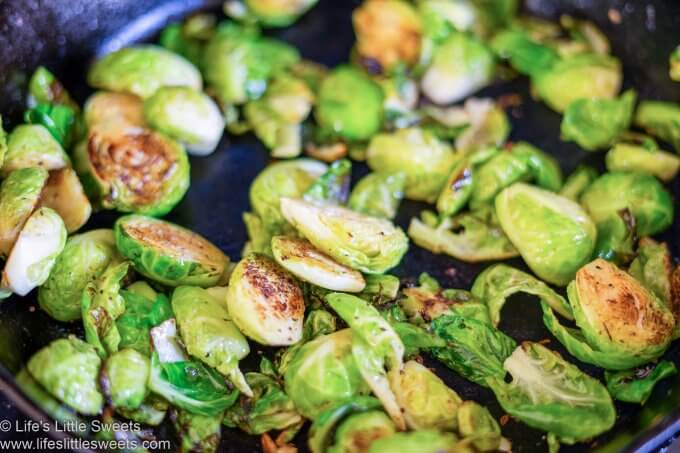 halved Brussels sprouts cooking in a pan