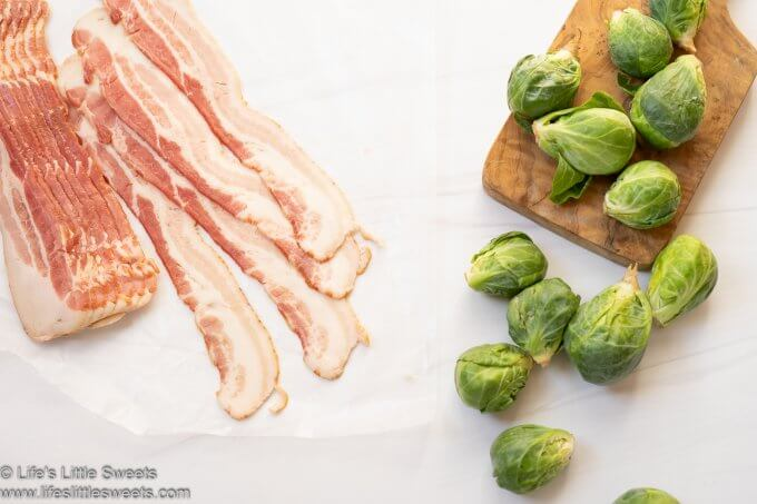 uncooked bacon strips and raw Brussels sprouts on a white surface