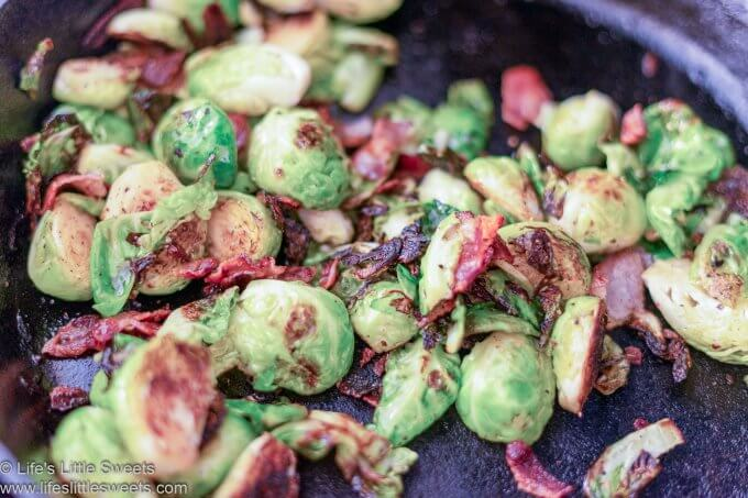 Brussels sprouts cooking in a pan with bacon bits