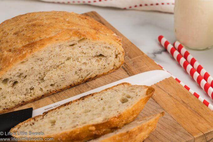 No-Knead Flaxseed Bread sliced on a wood cutting board