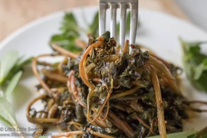 Sautéed Purslane with fork on a white plate