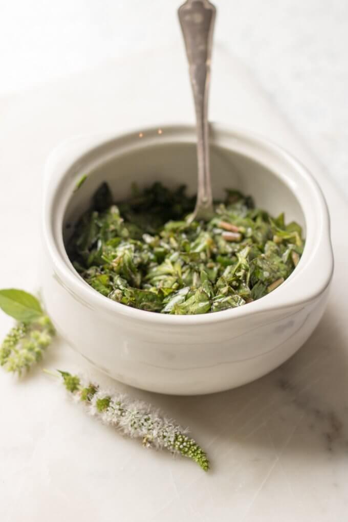 Purslane Herb Salad in a white crock bowl