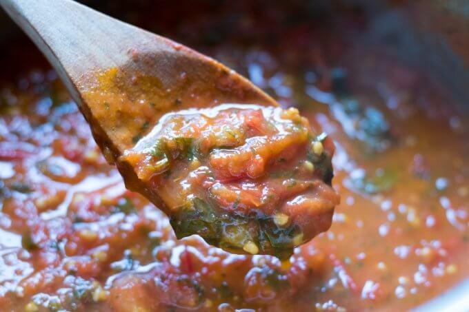 Tomato sauce on a wooden spoon